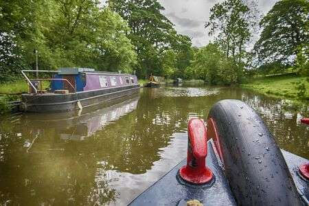 127480962-view-from-the-bow-of-boat-with-narrowboat